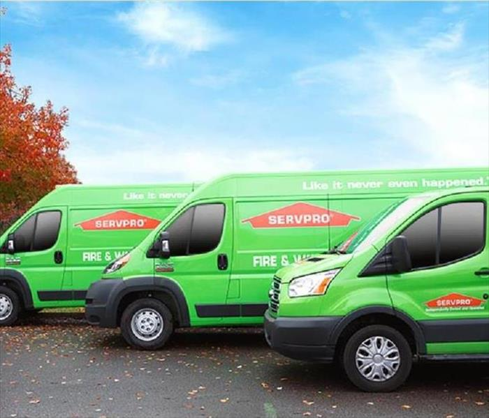 This picture show several SERVPRO vehicles parked.