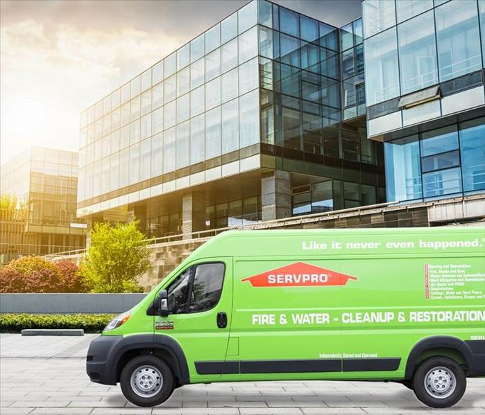 This picture shows a SERVPRO van outside of a commercial office building.