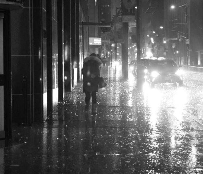 Rainy, dark street in city